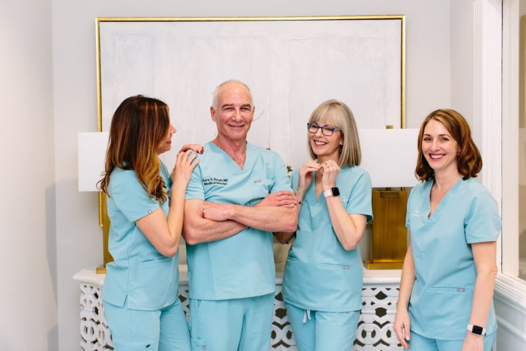Nurses laughing with Dr Gay Berger